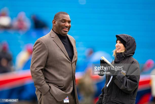 Senior Vice President of Player Personnel Doug Williams of the Washington Redskins speaks with Fox sports reporter Laura Okmin before the game...