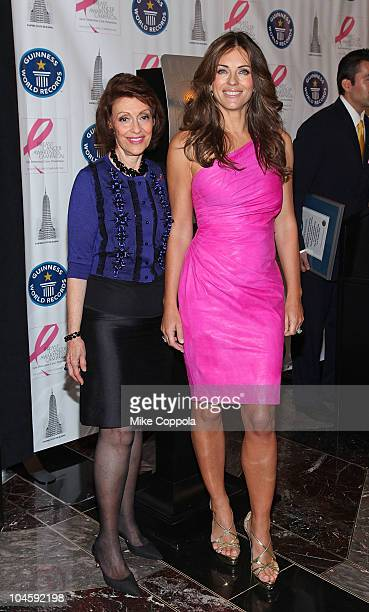 Senior Vice President of the Estee Lauder companies Evelyn Lauder and actress/model Elizabeth Hurley light The Empire State Building on October 1...