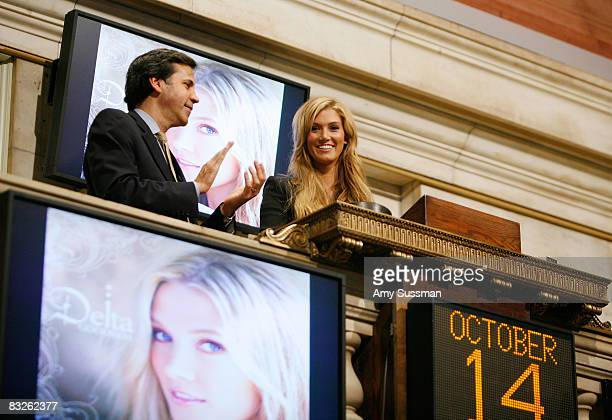 Senior Vice President of the Global Corporate Client Group for the New York Stock Exchange Thomas Veit and singer Delta Goodrem ring the opening bell...