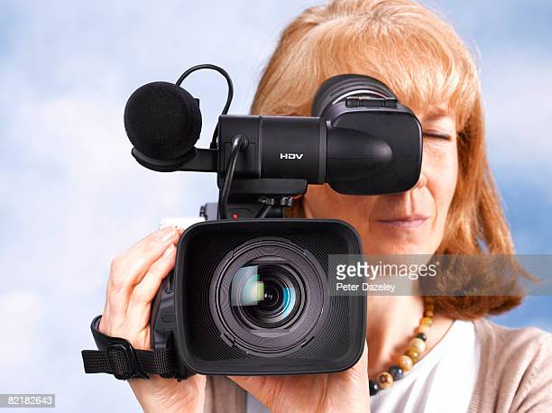 Senior video news camera woman