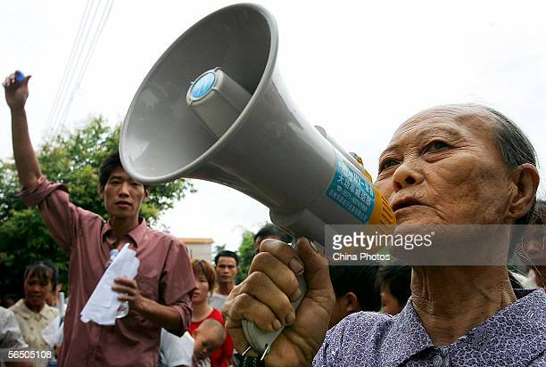 A senior villager gives a speech against the corruption of village committee director Chen Jinsheng during his term at a villagers' meeting of Taishi...