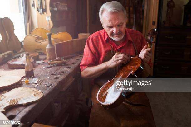senior violin maker - carving craft product stock photos and pictures