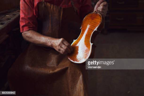 senior violin maker - instrument maker stock photos and pictures