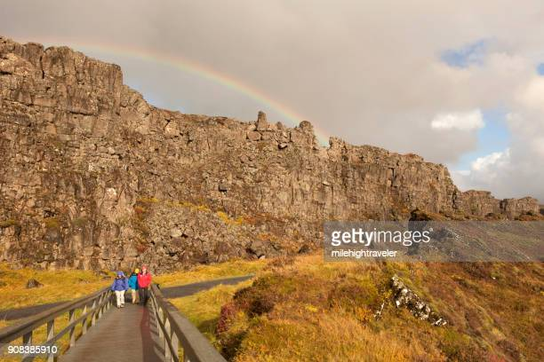 Senior visitors tourists explore Iceland pingvellir Thingvellir National Park rainbow