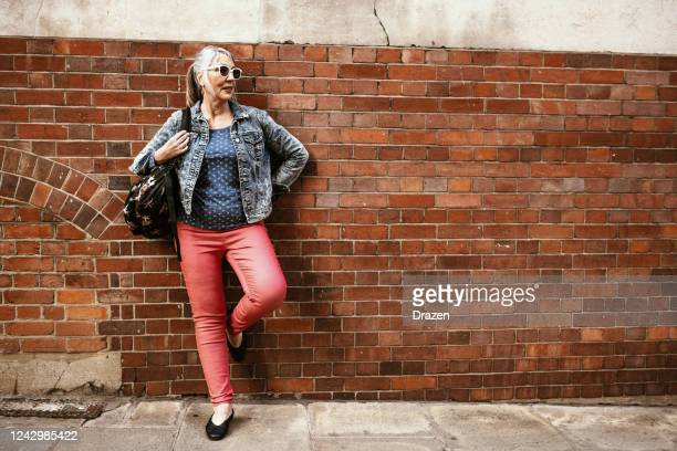 senior vital woman outdoors - northern european descent stock pictures, royalty-free photos & images