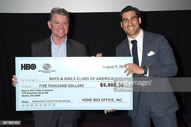 Senior VP of the Boys Girls Club Kevin McCartney presents HBO Sports Executive VP Peter Nelson with a check onstage during a QA following the LA...
