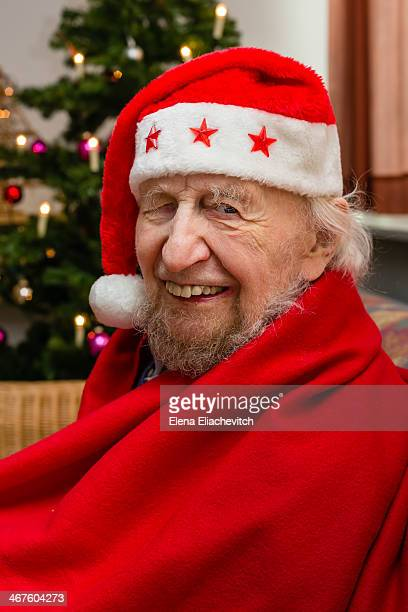 Senior wearing Santa Claus costume