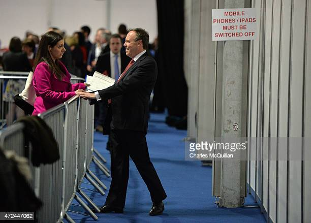 Senior Westminster politician Nigel Dodds smiles as he talks to Rebekah Robinson, daughter of DUP party leader Peter Robinson, as the General...