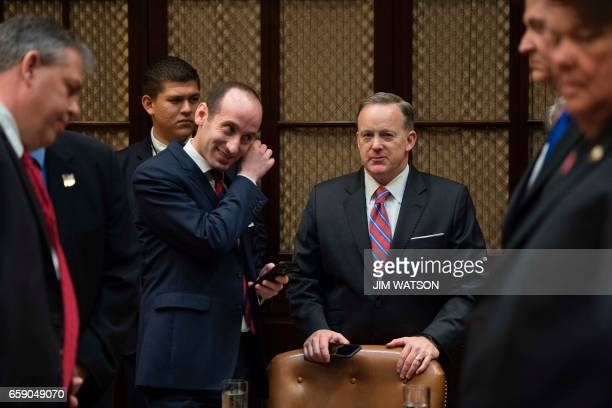 Senior White House Adviser Stephen Miller and White House Press Secretary Sean Spicer stand in during a listening session with the Fraternal Order of...