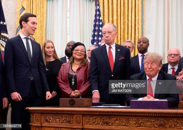 Senior White House Advisor Jared Kushner congratulates US President Donald Trump as he prepares to sign the First Step Act and the Juvenile Justice...