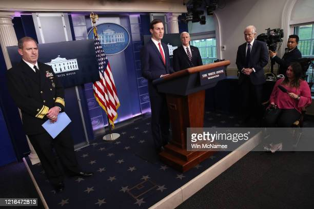 Senior White House Advisor Jared Kushner speaks with Navy Rear Adm John Polowczyk Vice President Mike Pence and Peter Navarro Director of Trade and...