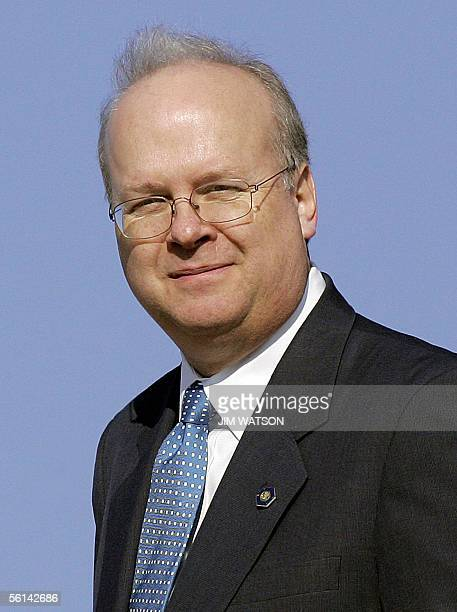 Senior White House Advisor Karl Rove looks on as he leaves Air Force One at Andrews Air Force Base after traveling with US President George W Bush to...