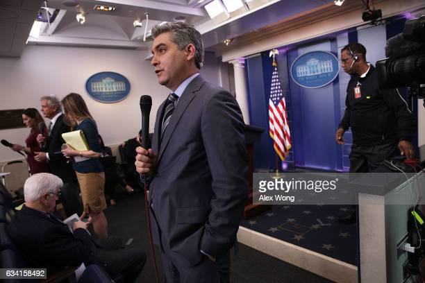 CNN senior White House correspondent Jim Acosta participates in a stand up shot as he reports after the White House daily briefing at the James Brady...