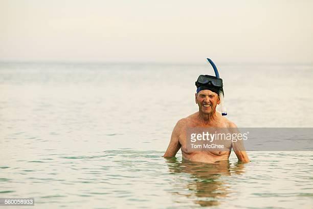 Senior white male wearing snorkeling gear