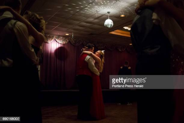 Senior Whitney Coro dances with her boyfriend Gavin Beard after she was crowned prom queen during Carrabec High School's prom at Tb Celebration Center