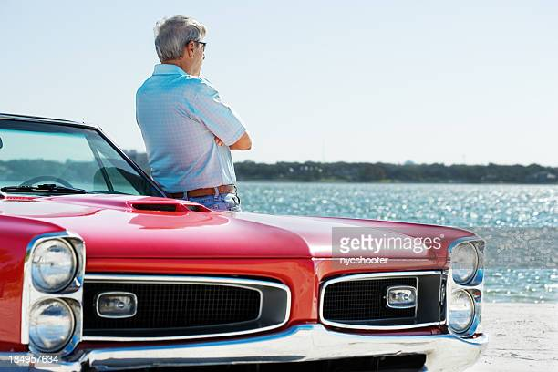 Senior with classic convertible car