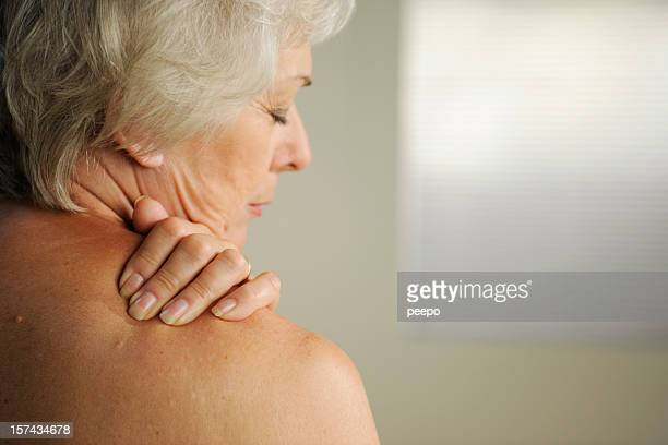 senior with neck pain - pijn stockfoto's en -beelden