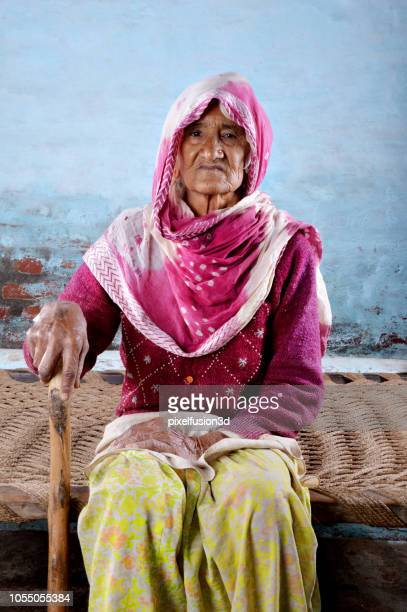 senior wmen of indian ethnicity sitting portrait at home. - dupatta stock pictures, royalty-free photos & images