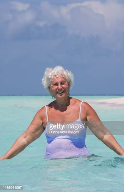 senior woman a tropical sea - vilamendhoo stock photos and pictures