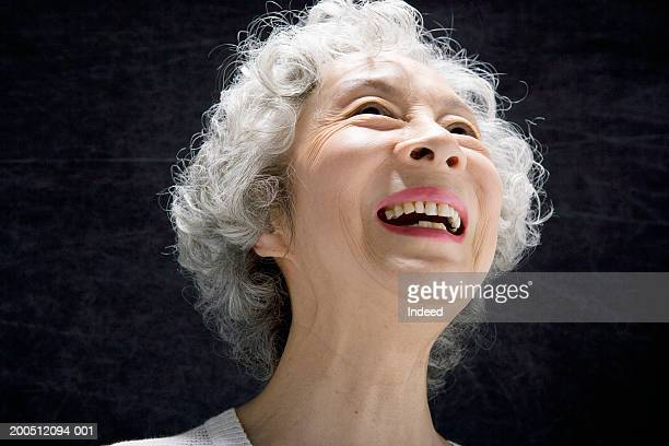 senior woman, against black background, smiling, close-up - white hair stock pictures, royalty-free photos & images