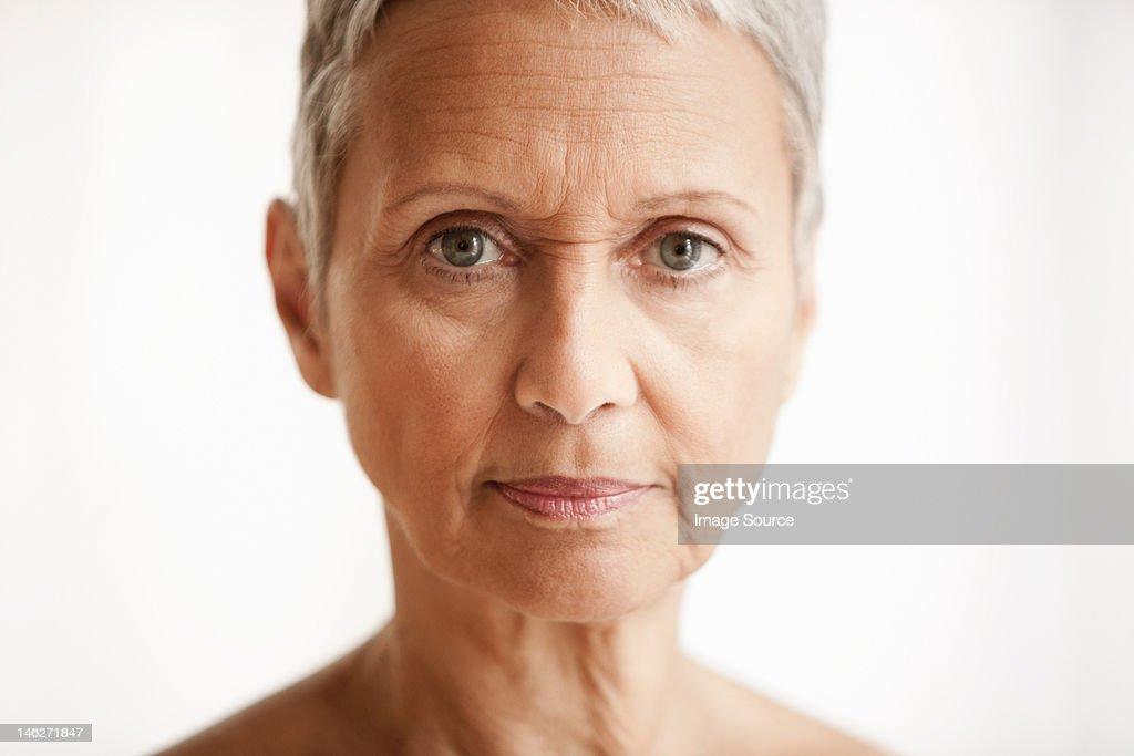 Senior woman against white background, portrait : Stock Photo
