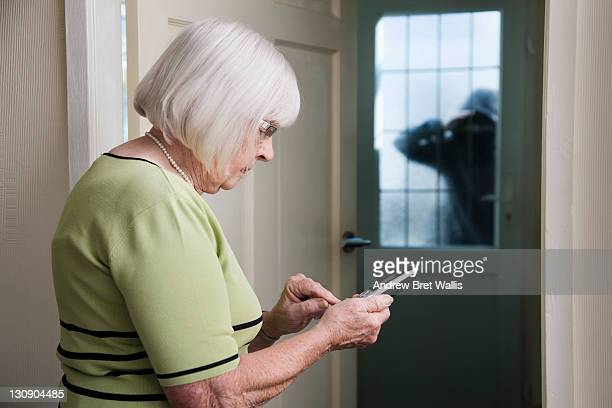 senior woman alarmed by stranger calls for help - stranger stock photos and pictures