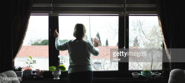 senior woman alone at home becouse of isolation quarantine coronavirus covid 19 - remote location stock pictures, royalty-free photos & images