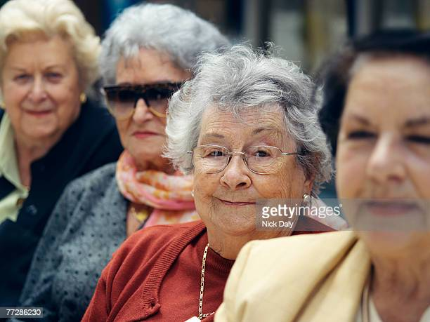 senior woman amid others - category:cs1_maint:_others stock pictures, royalty-free photos & images
