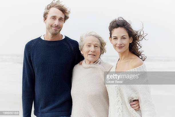 Senior woman and adult children on the beach