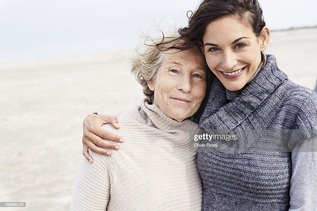 Senior woman and adult daughter on the beach : Stock Photo