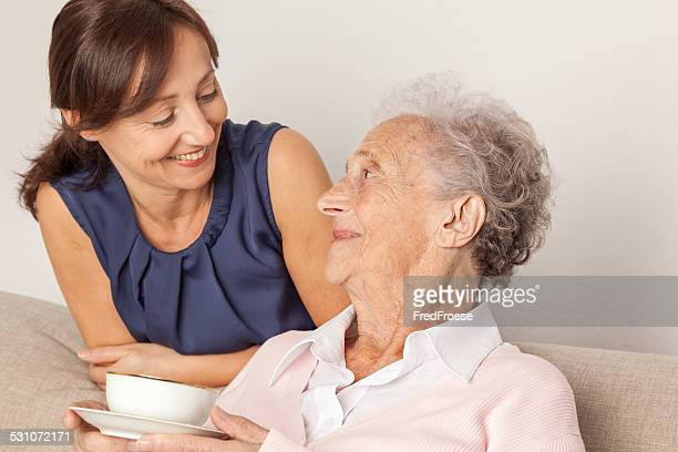 Senior woman and caregiver at home