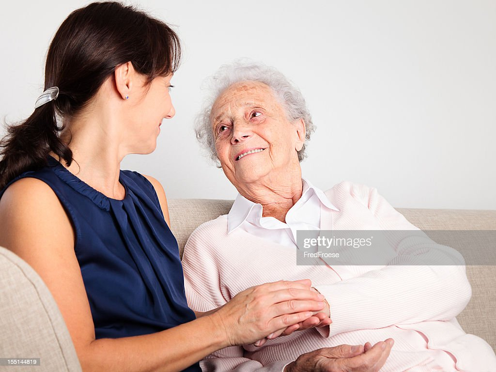 Senior woman and caregiver : Stock Photo