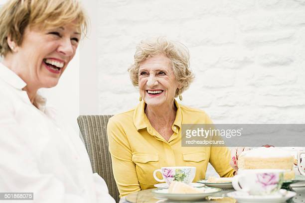 Senior woman and daughter having tea