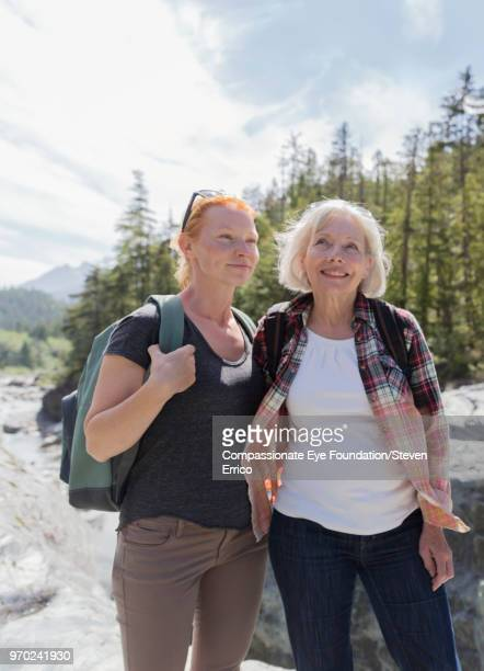 Senior woman and daughter hiking in mountains