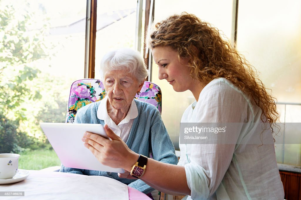 senior woman and digital tablet : Stock Photo