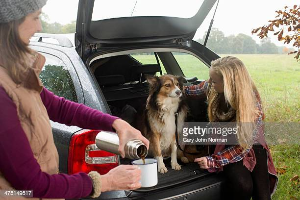 Senior woman and granddaughter with dog