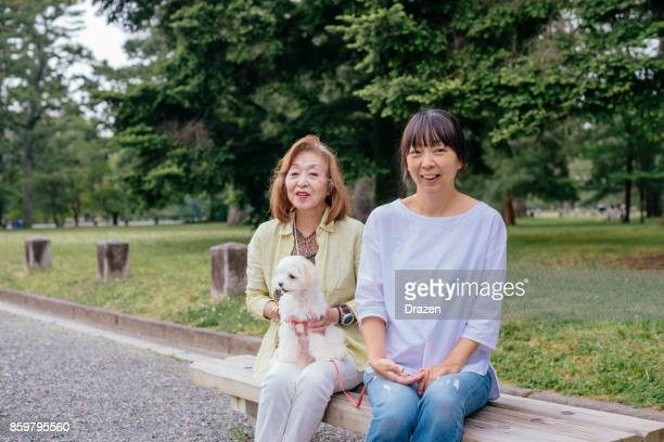 Senior woman and her daughter spending time together in park