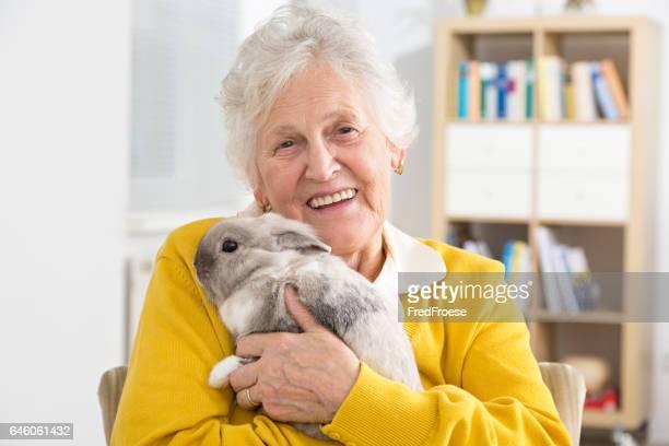 Senior woman and little rabbit