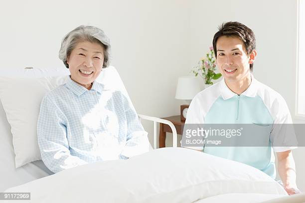 Senior woman and male care worker, portrait