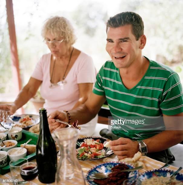 senior woman, and man, at garden dinner