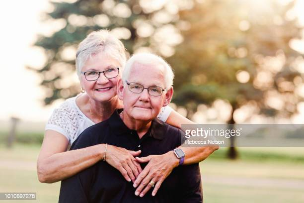 senior woman and man posing for camera