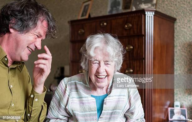 Senior woman and mature man laughing