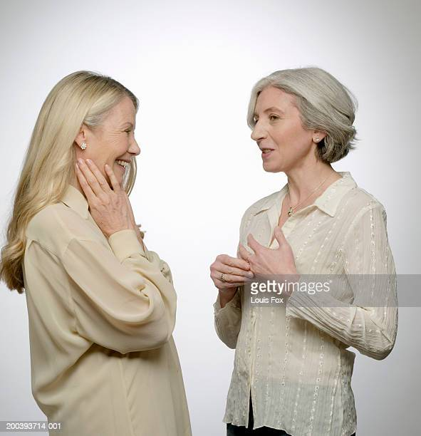 Senior woman and mature woman talking, side view
