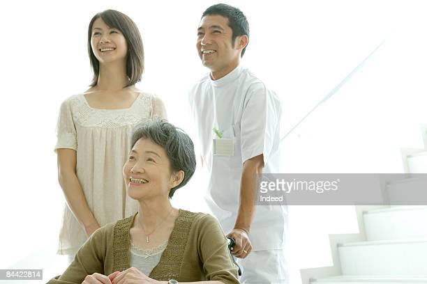 Senior woman and mid adult woman with male nurse