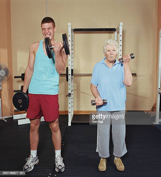 Senior woman and teenage boy (16-18) exercising with hand weights
