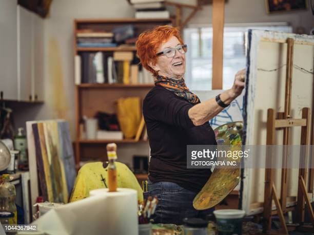 senior woman artist at work - parte do corpo humano imagens e fotografias de stock