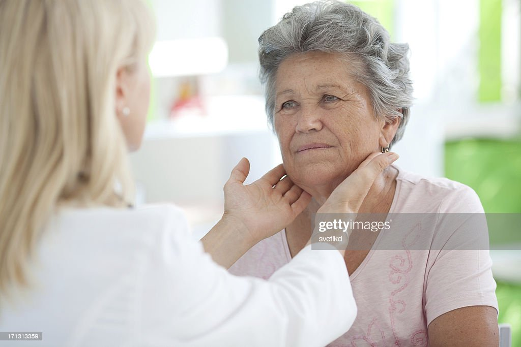 Senior woman at doctor's office. : Stock Photo
