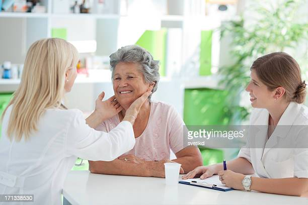 senior woman at doctor's office. - goiter stock pictures, royalty-free photos & images
