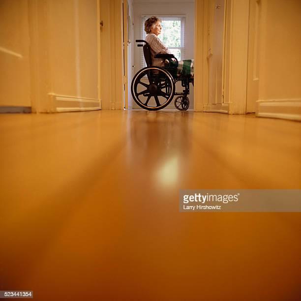 Senior Woman at Home in Wheelchair