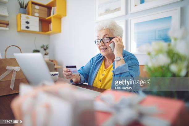 senior woman at home - black friday stock photos and pictures